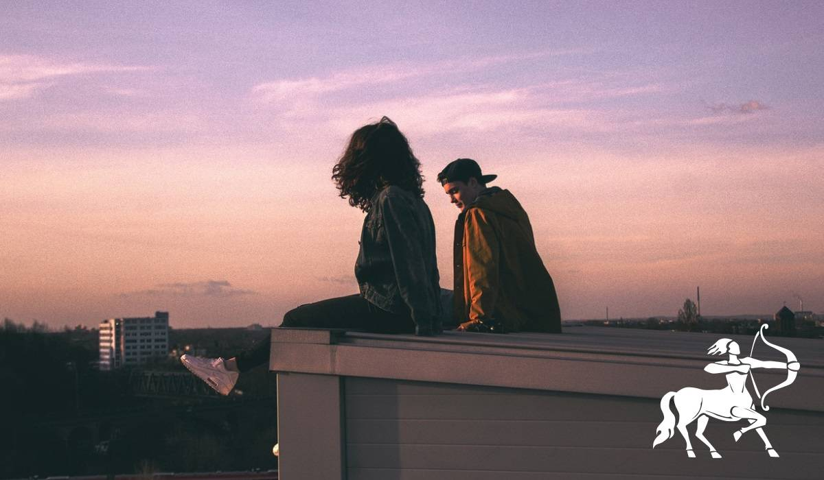 couple sitting on a rooftop