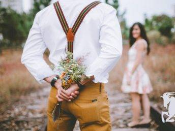 Man gifting flowers