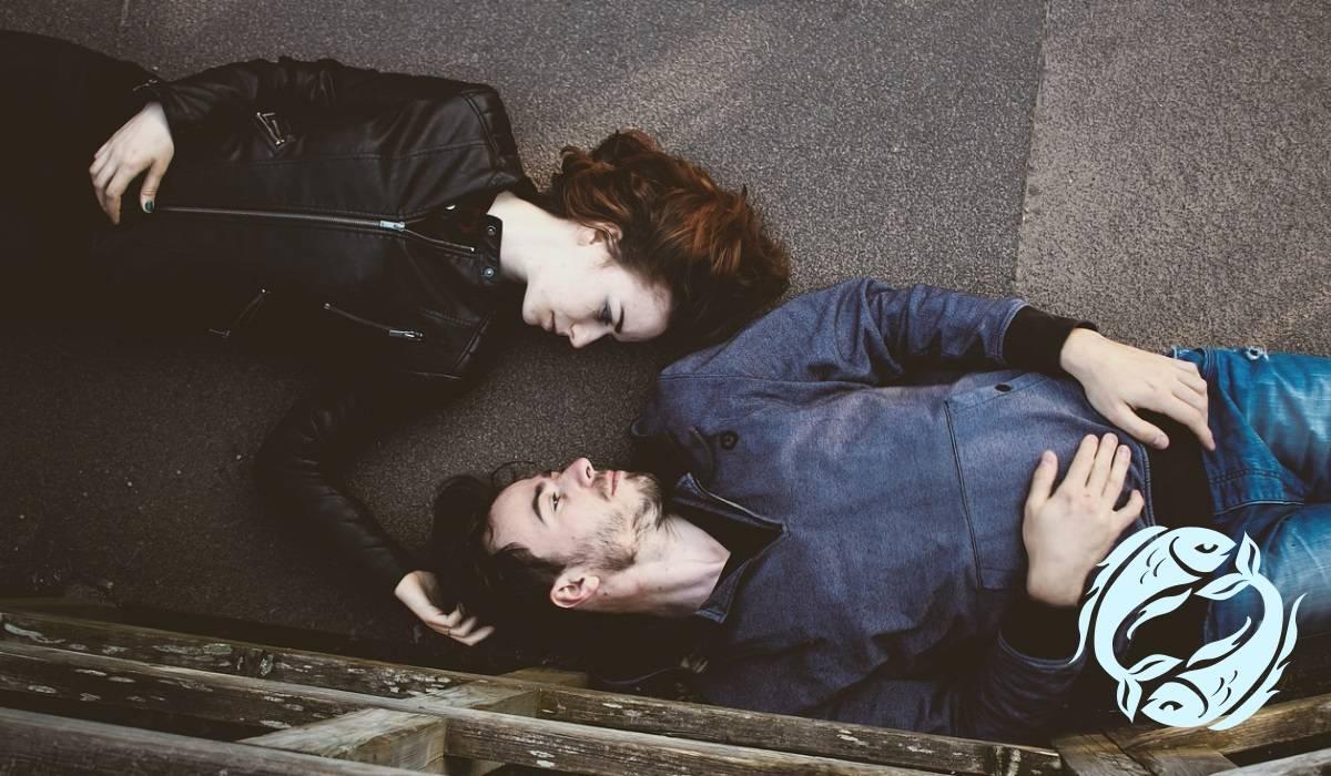 Couple embracing on pavement